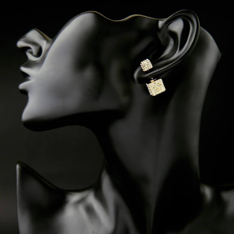 detail of box earring in stud design